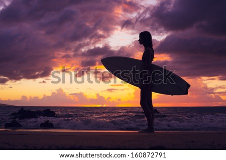 Beautiful sexy surfer girl in bikini on the beach at sunset, silhouette - stock photo