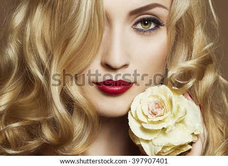 Beautiful Sexy Woman face closeup, makeup with Red Lips and Nails. Beauty blond Girl. Passion. Makeup, Hairdo and Manicure. Sensual Mouth. Sexy Red Color Lips.Gold background - stock photo