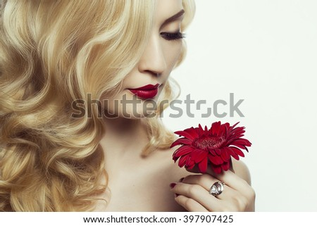 Beautiful Sexy Woman face closeup, makeup with Red Lips and Nails. Beauty blond Girl. Passion. Makeup, Hairdo and Manicure. Sensual Mouth. Sexy Red Color Lips. white background - stock photo