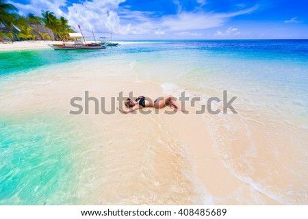 Beautiful sexy woman, has tan sport body, dressed bikini. Tropical blue sun sea in Philippines. Luxury holiday resort. Island atoll about coral reef. Fresh freedom. Adventure day. - stock photo
