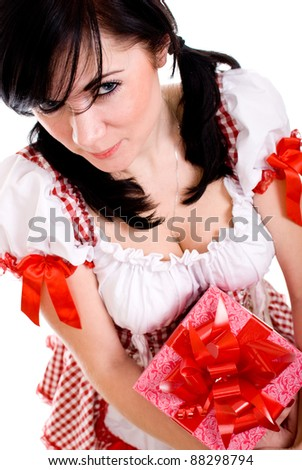 Beautiful sexy woman holding a gift isolated on white background