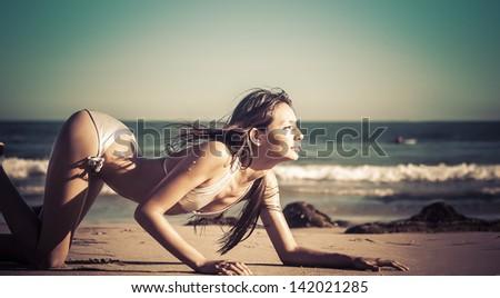 Beautiful sexy woman in bikini on beach - stock photo
