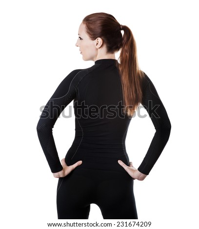 Beautiful sexy woman in black hot sports thermolinen underwear for downhill skiing isolated on white background stay back. T-shirt with long sleeves and leggings