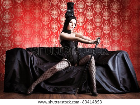 Beautiful sexy woman in black lingerie over vintage background. - stock photo