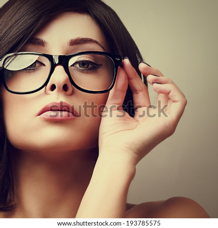 Beautiful sexy woman in fashion glasses looking. Vintage portrait - stock photo