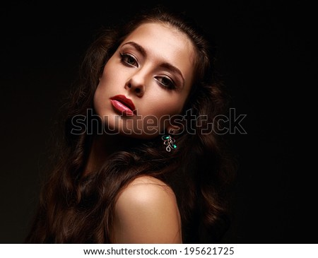 Beautiful sexy woman looking with long hair on black background
