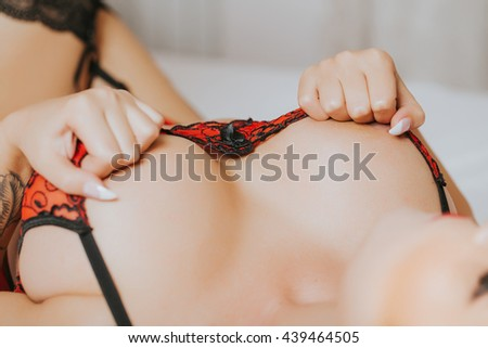 Beautiful sexy woman on the bed - stock photo