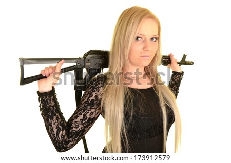 Beautiful sexy woman posing with a gun over white background.  - stock photo