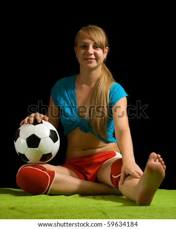 Beautiful sexy woman posing with soccer ball