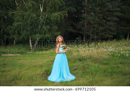 Beautiful sexy woman walk in the park summertime weather green trees road wear stylish short dress for party and walk glamour fashion clothes