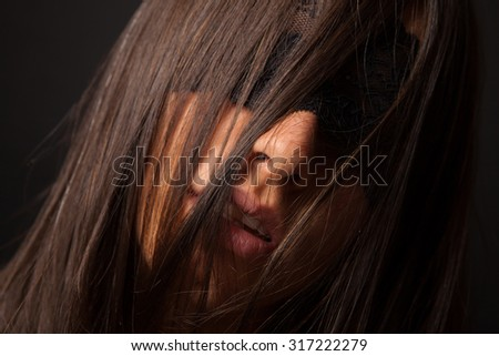 Beautiful sexy woman with blindfold. - stock photo