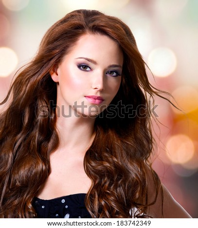 Beautiful sexy woman with brown long hairs over art background - stock photo