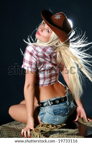 Beautiful sexy woman with cowboy hat - stock photo