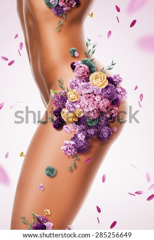 beautiful sexy woman with different flowers on body - stock photo