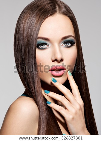 Beautiful sexy woman with green nails  - stock photo