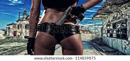 Beautiful sexy woman with gun - stock photo