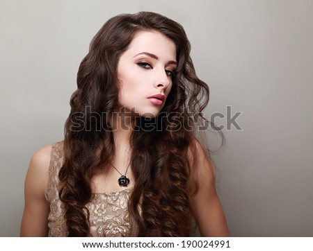 Beautiful sexy woman with long curly hair on empty copy space background
