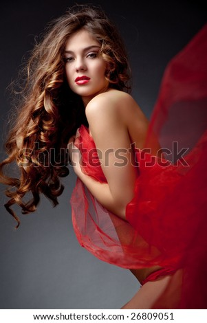 Beautiful sexy woman with long curly hair studio shot