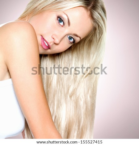 Beautiful sexy woman with long straight white hair looking at camera - stock photo
