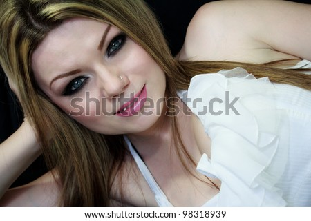 Beautiful sexy woman with make-up, on black background - stock photo