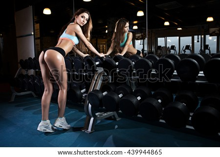 beautiful sexy woman with perfect buttocks at the gym - stock photo
