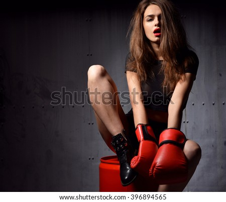 Beautiful sexy woman with red Boxing Gloves at the gym concept about sport  fitness martial arts on a dark modern background