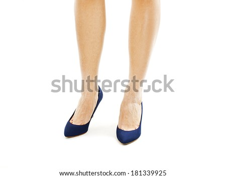 Beautiful, sexy, women's legs in blue shoes. Isolated on white background  - stock photo