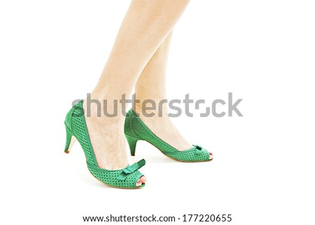 Beautiful, sexy, women's legs in green shoes. Isolated on white background  - stock photo