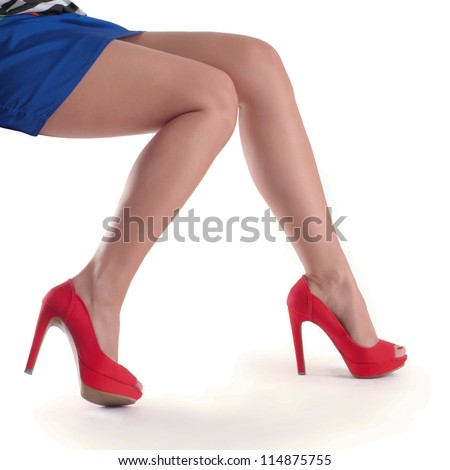 Beautiful, sexy, women's legs in red shoes on a white background. - stock photo