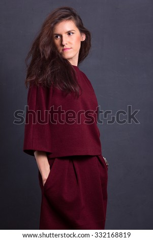 Beautiful sexy young business woman brown hair with natural skin wearing wine-coloured dress suit top skirt business clothes for meetings walks autumn fall collection perfect body shape party style. - stock photo