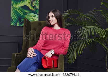 Beautiful sexy young business woman hair evening makeup wear sweater wool pants high heels shoes business clothes meeting walk autumn fall collection perfect body shape make-up interior palm chair  - stock photo