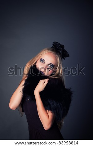 beautiful sexy young girl make up as a witch for Halloween, halloween party, halloween costume, halloween witch, woman Halloween, scary halloween, spooky halloween image - stock photo