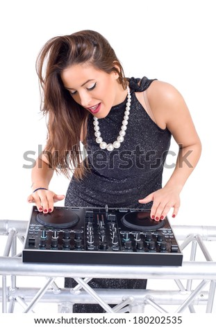 Beautiful Sexy Young Woman as DJ playing music on (pickup) mixer. Isolated on a white background. Studio shot