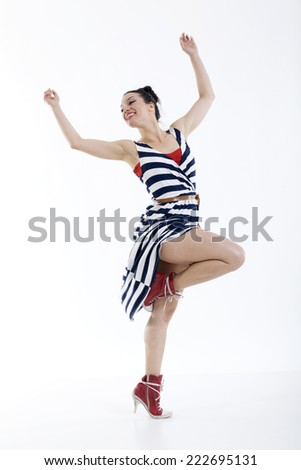 Beautiful sexy young woman dancing isolated in studio - stock photo
