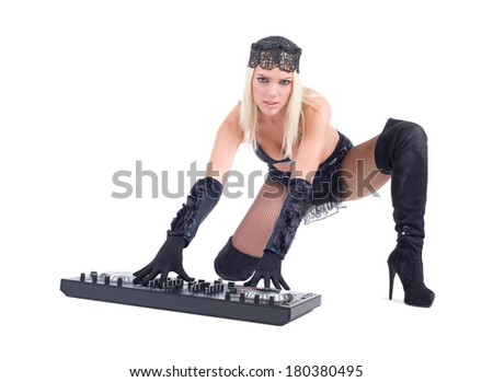 Beautiful Sexy Young Woman playing music on (pickup) mixer. Isolated on a white background. Studio shot - stock photo