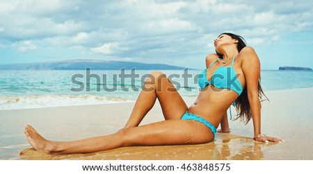 Beautiful sexy young woman relaxing on the beach