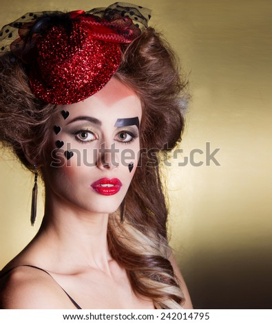 beautiful sexy young woman with beautiful makeup and hairdo in a little red hat with large lips with hearts on the face, the feast day of St. Valentine - stock photo