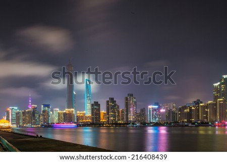 beautiful shanghai bund with curved light trails on the street in evening