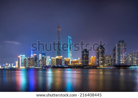 beautiful shanghai bund with curved light trails on the street in evening - stock photo
