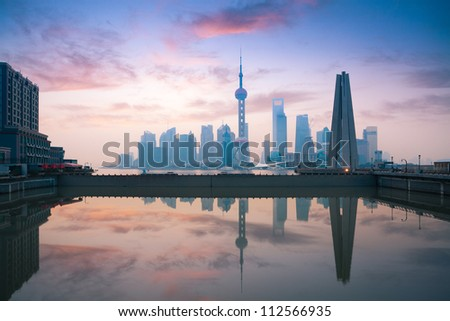 beautiful shanghai, rosy dawn reflection in the river - stock photo