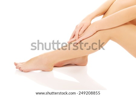 Beautiful shaved perfect female legs. - stock photo