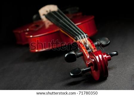 beautiful shiny fiddle on dark velvet bakground - stock photo