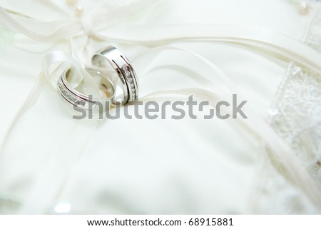 beautiful shiny wedding rings with diamonds on white