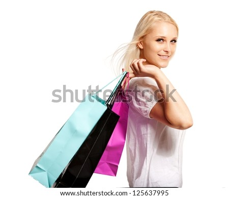 Beautiful shopper smiling and looking happy after shopping