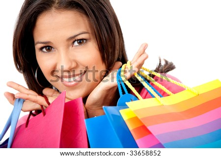 Beautiful shopping girl holding some bags isolated