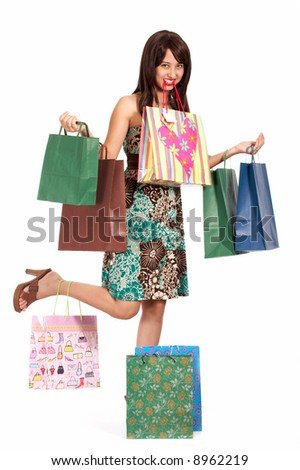 beautiful shopping girl overloaded with shopping bags - stock photo