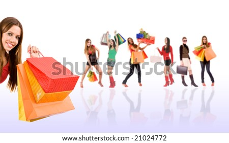 Beautiful shopping girl with colorful bags and blurred woman in background.