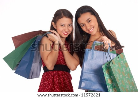 Beautiful shopping girls holding lots of shopping bags - stock photo