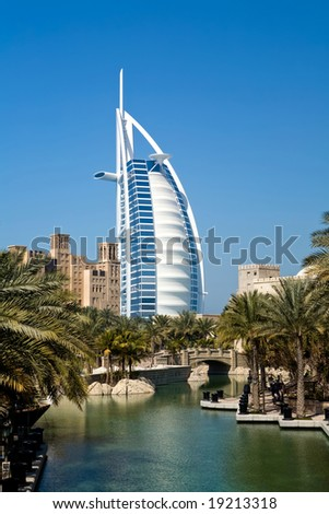 Beautiful shopping mall Souk Madinat Jumeirah and famous hotel Burj Al Arab in Dubai, UAE - stock photo