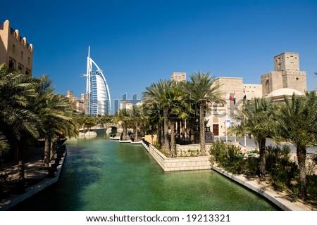 Beautiful shopping mall Souk Madinat Jumeirah and famous hotel Burj Al Arab in Dubai, UAE - stock photo